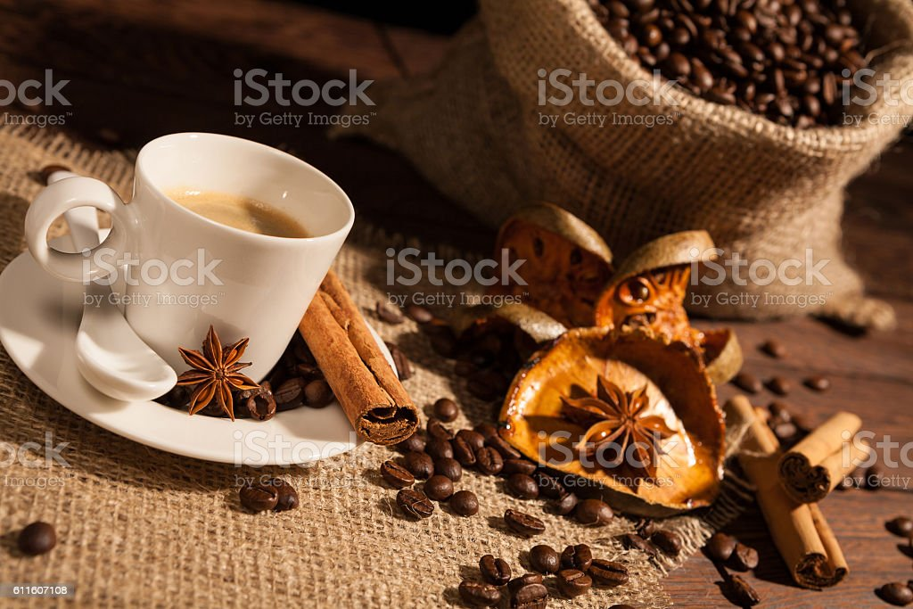 Close-up of coffee cup with star anise and cinnamon stock photo