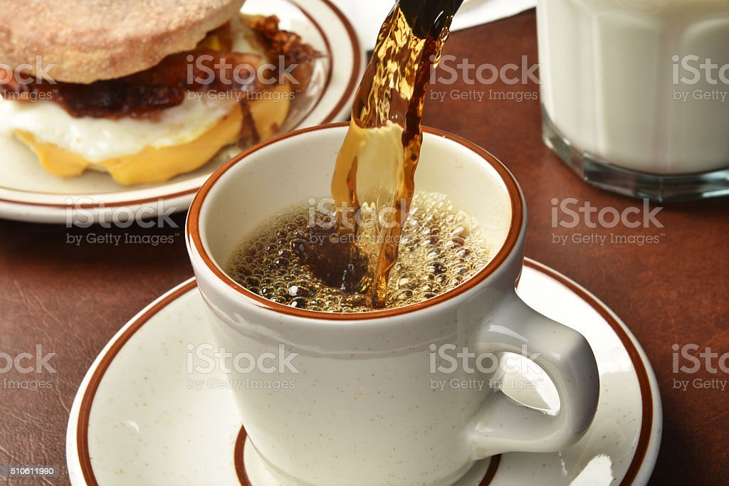 Closeup of coffee pouring stock photo