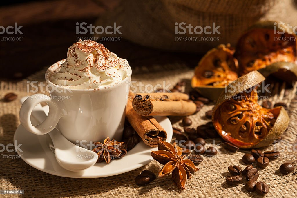 Close-up of coffee with whipped cream and cocoa powder stock photo