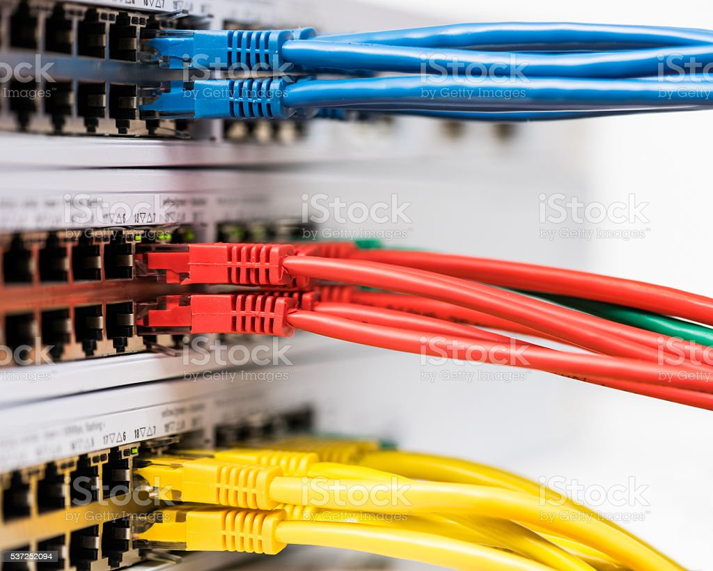 Closeup of  colored computer network cables  connected to a  switch stock photo