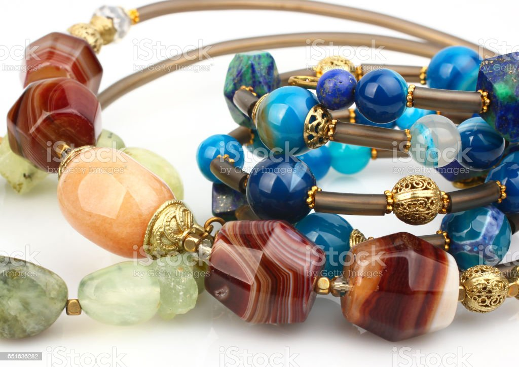 Close-up of colorful natural precious gems jewelry on white stock photo
