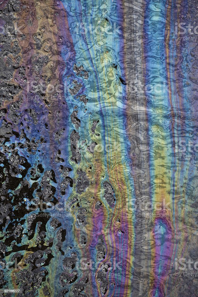 Closeup of Colorful Oil Spill over Asphalt royalty-free stock photo