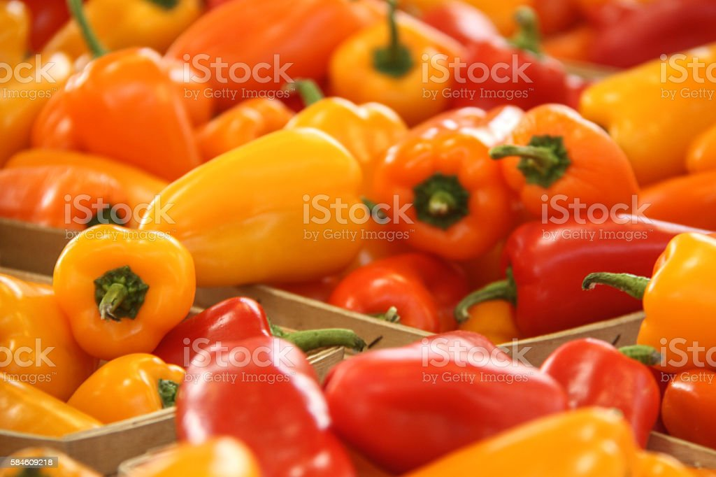 Closeup Of Colorful Sweet Mini Peppers in Baskets stock photo