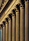 A close-up of columns on the exterior of a courthouse