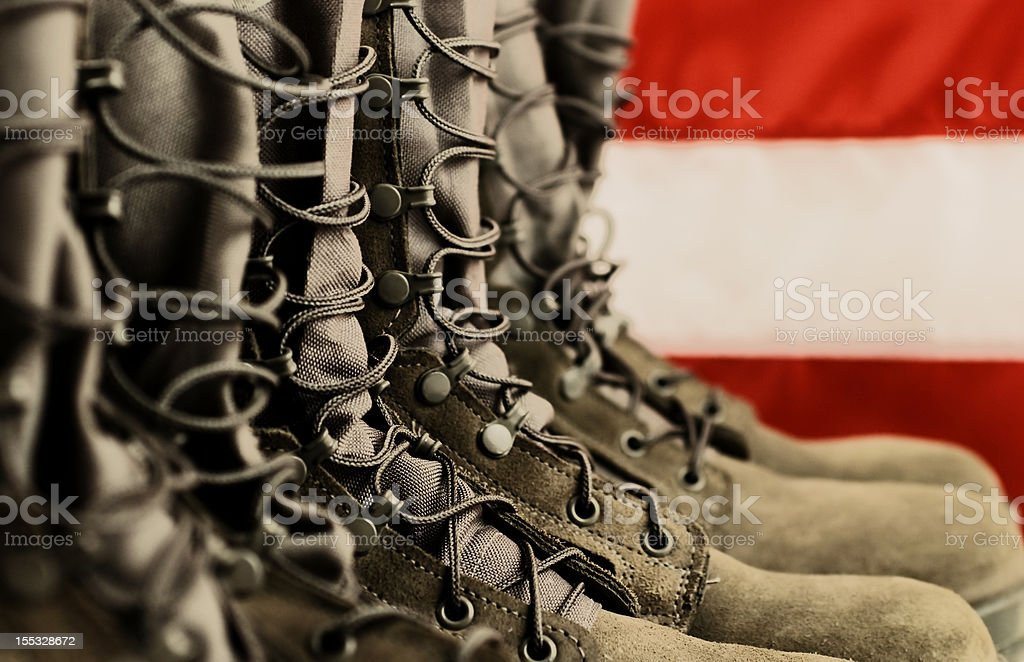 Close-up of combat boots in front of American flag stock photo
