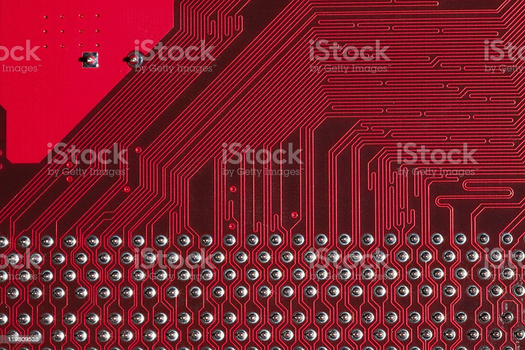 Closeup of computer circuit board in red royalty-free stock photo