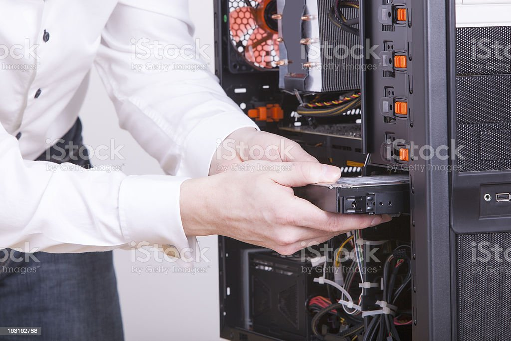 Closeup of computer engineer replacing hard drive in rack royalty-free stock photo