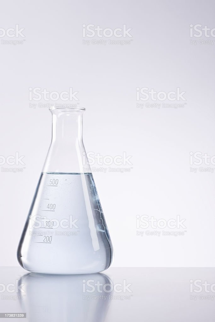 Closeup of conical flask filled with liquid stock photo
