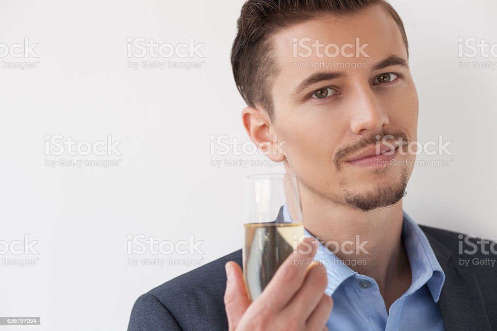 Closeup of Content Male Manager Raising Glass stock photo