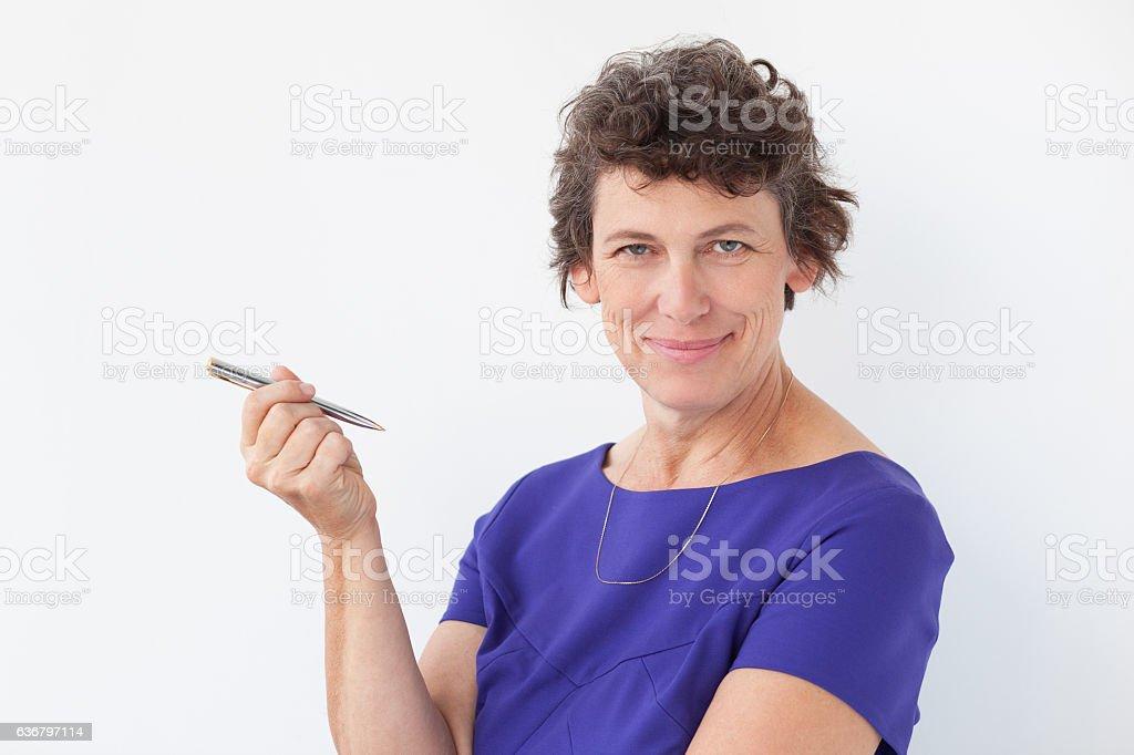 Closeup of Content Senior Lady Holding Pen stock photo