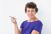 Closeup of Content Senior Lady Holding Pen