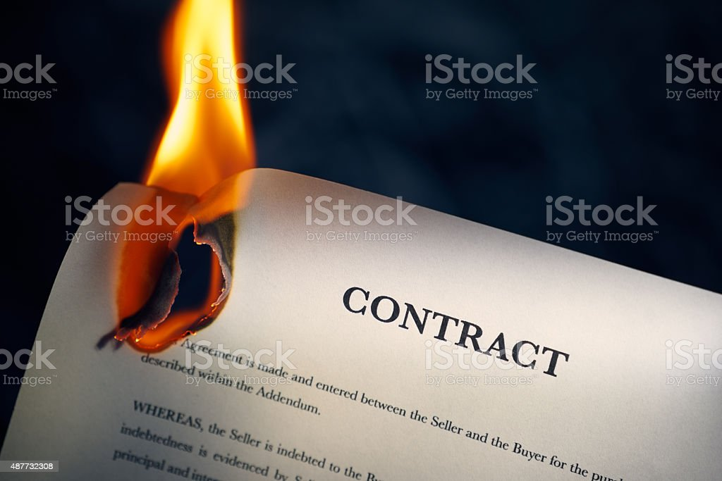 Closeup Of Contract In English Burning On Fire stock photo