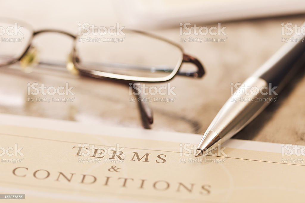 Close-up of contract with pair of glasses and pen stock photo