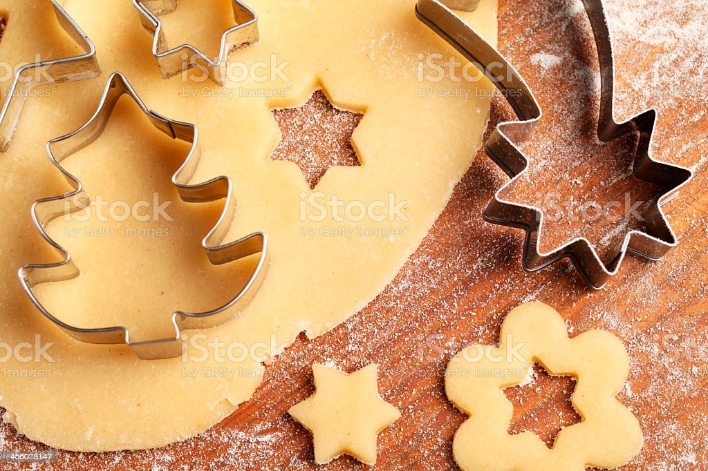 A close-up of cookies being cut out royalty-free stock photo