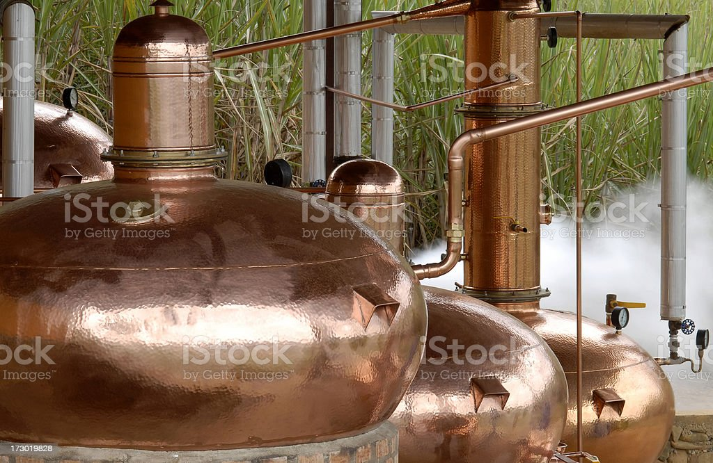 Close-up of copper pots use as a distillery outdoors stock photo
