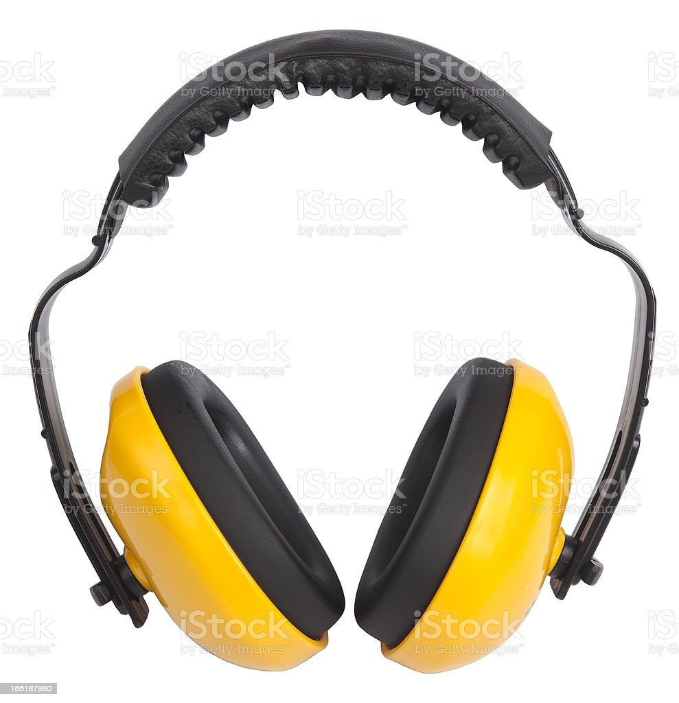 Close-up of cordless yellow ear muffs on white background stock photo