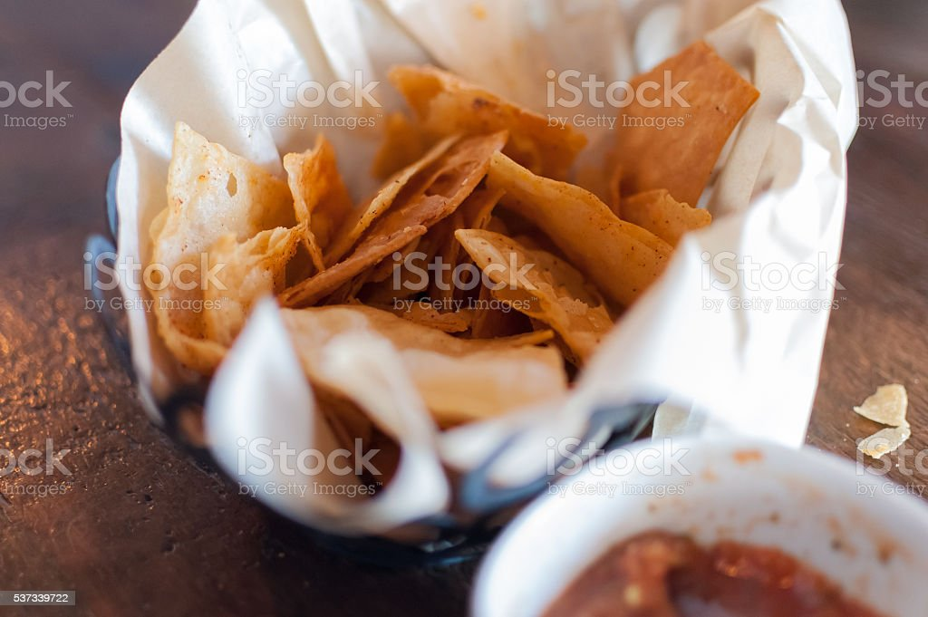 Close-up of corn chips and bowl of salsa stock photo