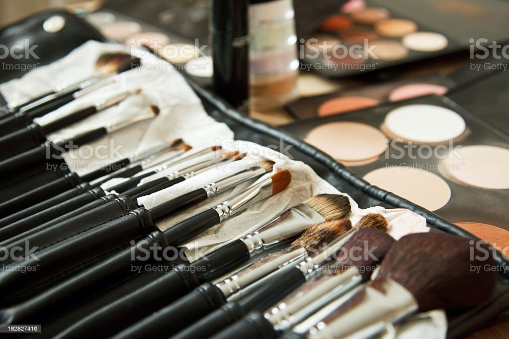 Close-up of cosmetics and make up brushes royalty-free stock photo
