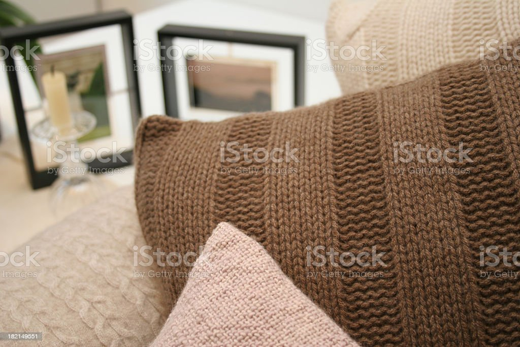 Close-up of couch cushions and photos in a lounge room royalty-free stock photo