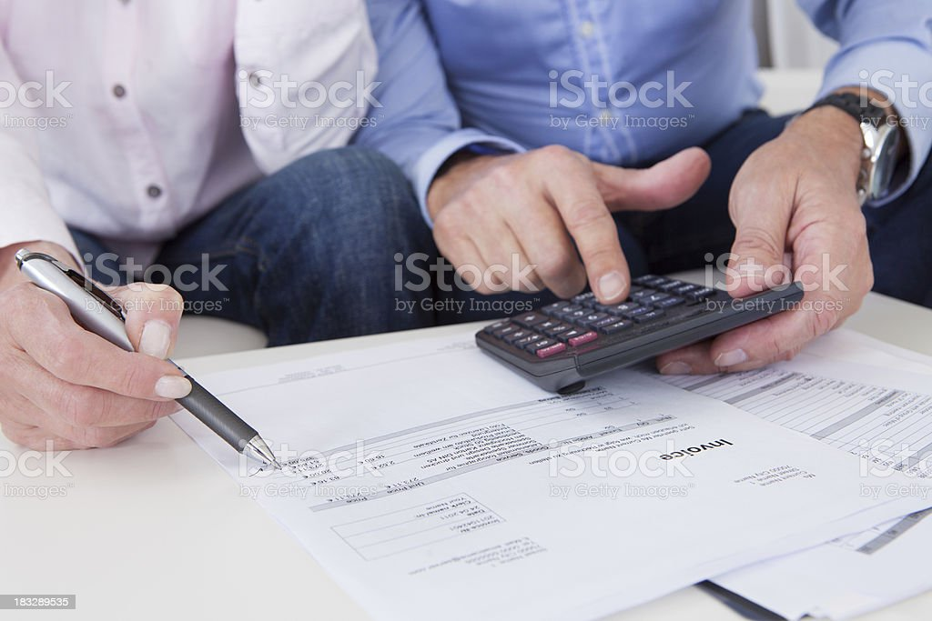 Close-up of couple doing finances at home stock photo