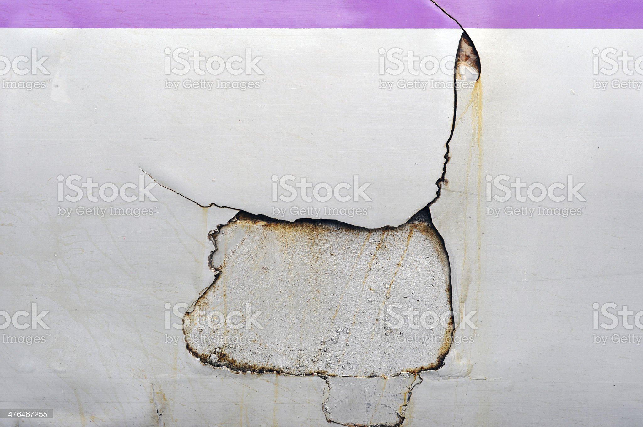 Closeup of cracked and peeling paint on an old car royalty-free stock photo