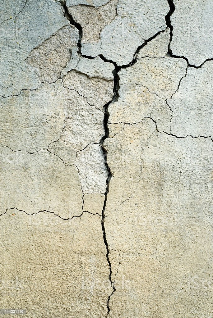 Close-up of cracked gray concrete stock photo