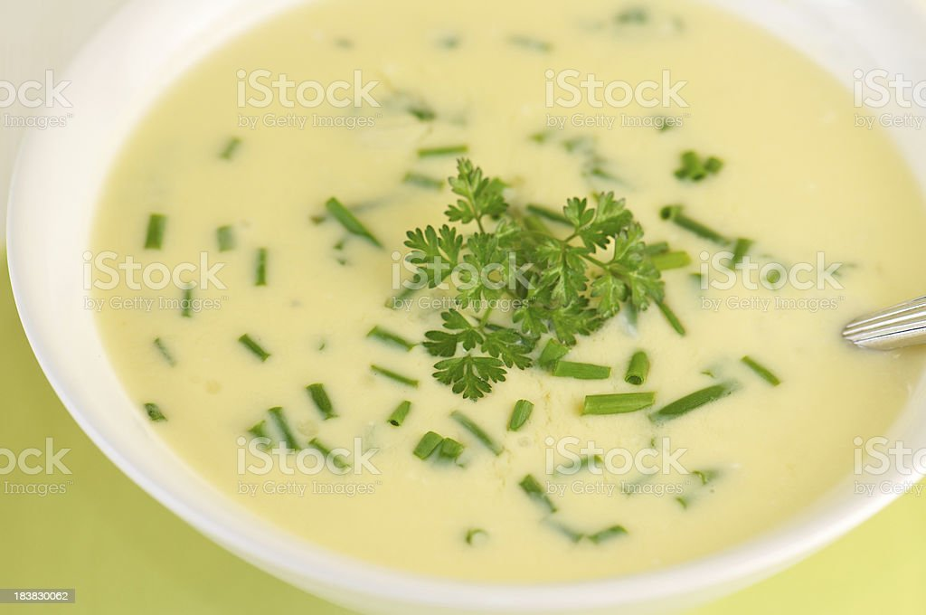 Close-up of Creamy Avgolemono Soup with Chopped Herbs stock photo