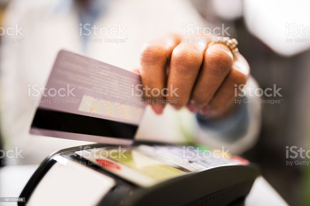 Close-up of credit card payment in pharmacy. stock photo