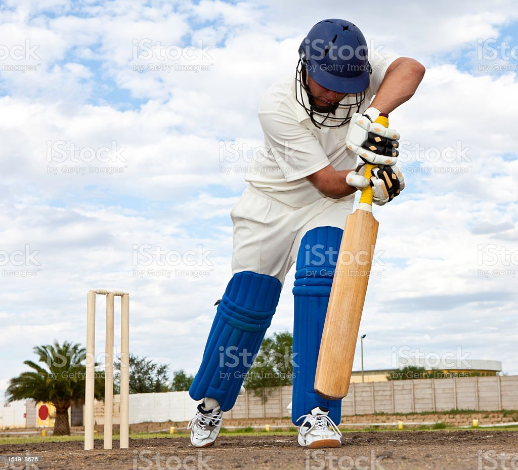 Close-up of Cricket player getting ready to strike stock photo
