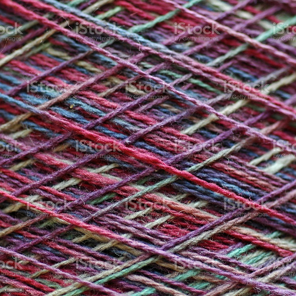closeup of crosswound strands of yarn on a cone royalty-free stock photo