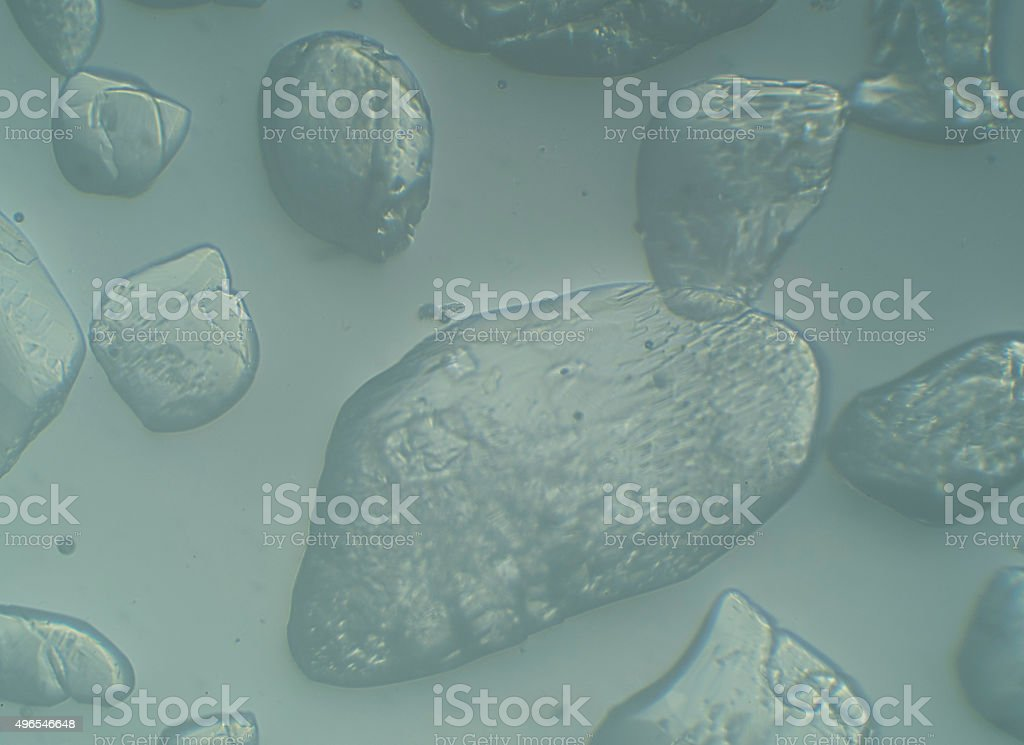Close-up of crystalline sugar dissolves in water stock photo