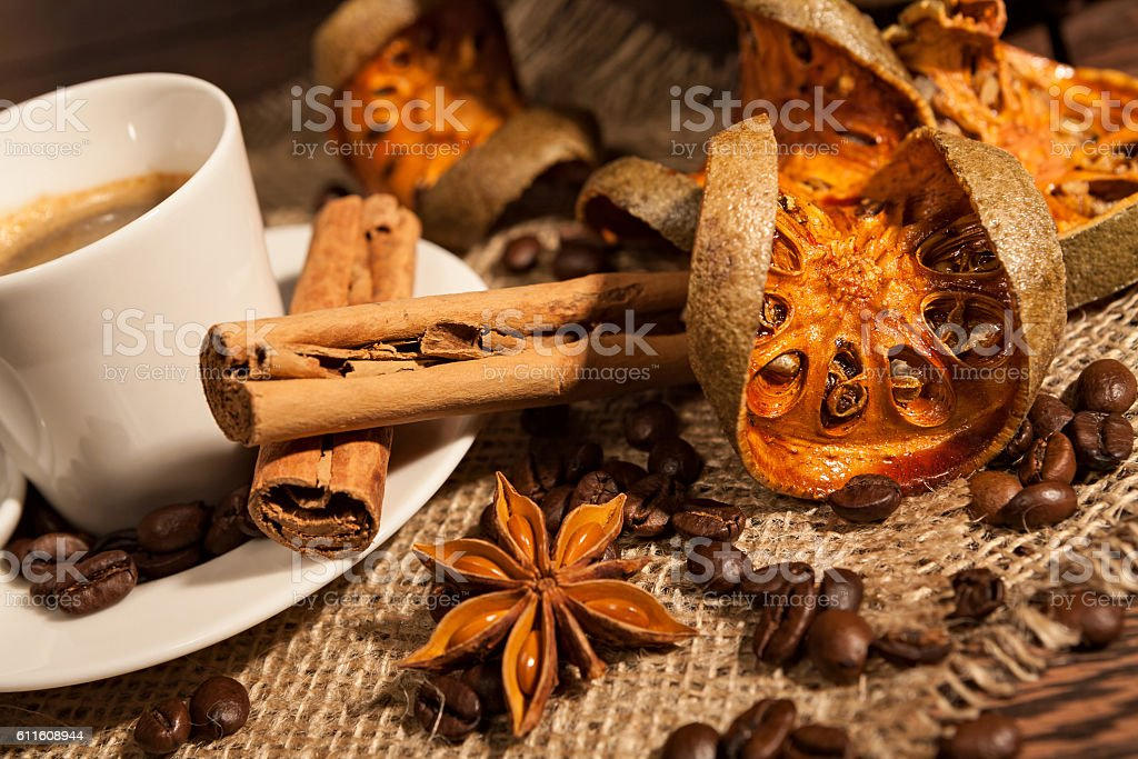 Close-up of cup of coffee with cinnamon and star anise stock photo