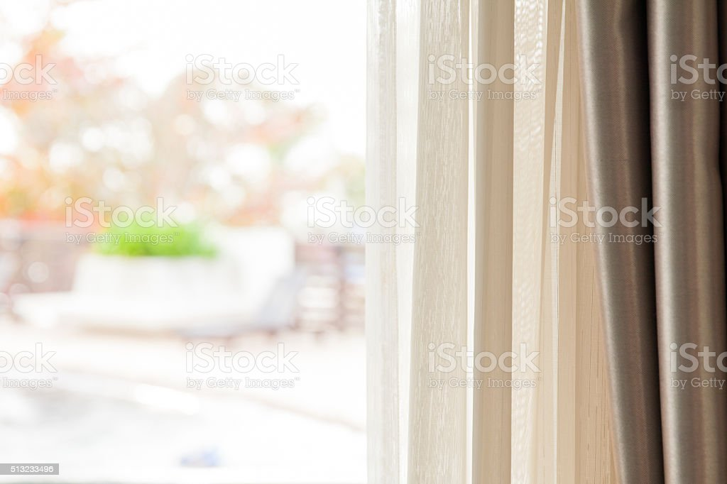 Close-up of curtains with blurred poolside background stock photo