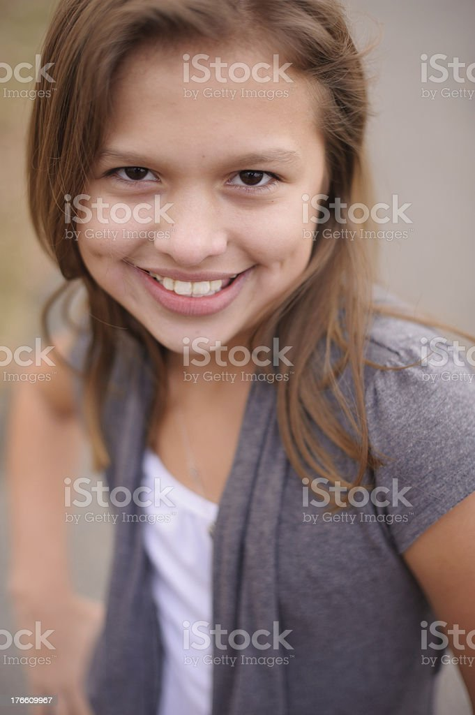 Closeup of Cute Girl with Dimples Standing Outside royalty-free stock photo