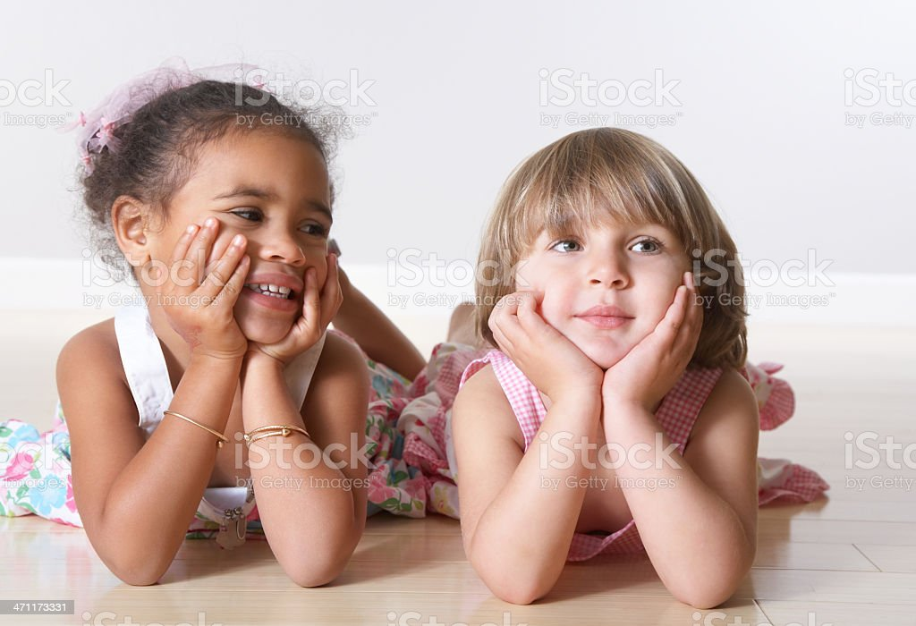 Closeup of cute little girls with hands on chin royalty-free stock photo