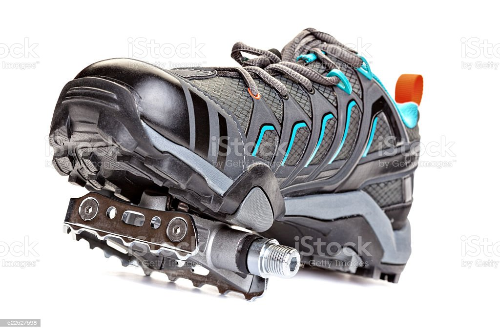 Closeup of cycling shoes with pedal attached to the sole. stock photo