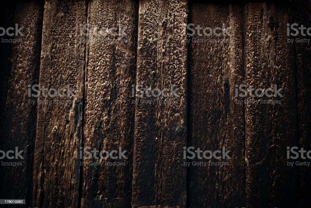 Close-up of dark textured old wood royalty-free stock photo