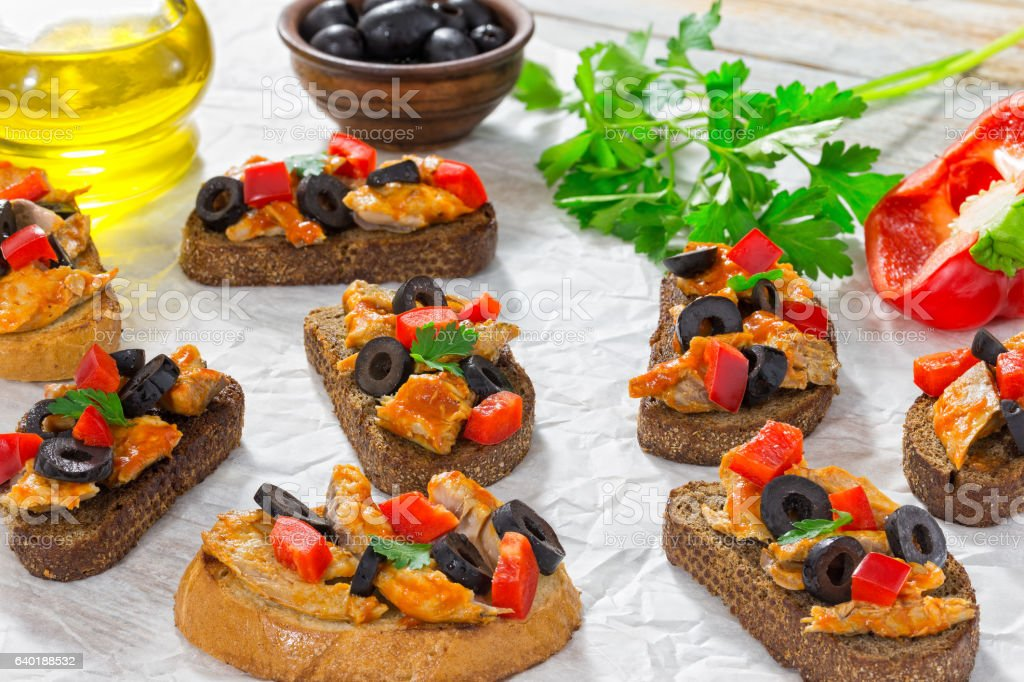 close-up of delicious bruschetta with pieces of mackerel fish stock photo