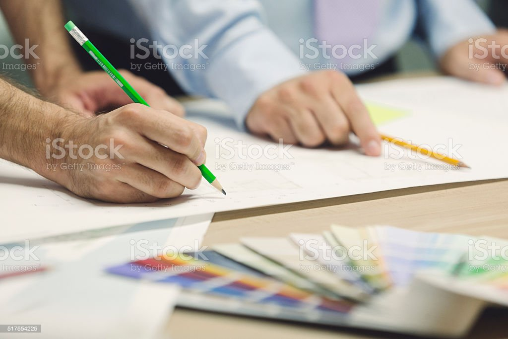 Closeup of designers hand with pencil. stock photo