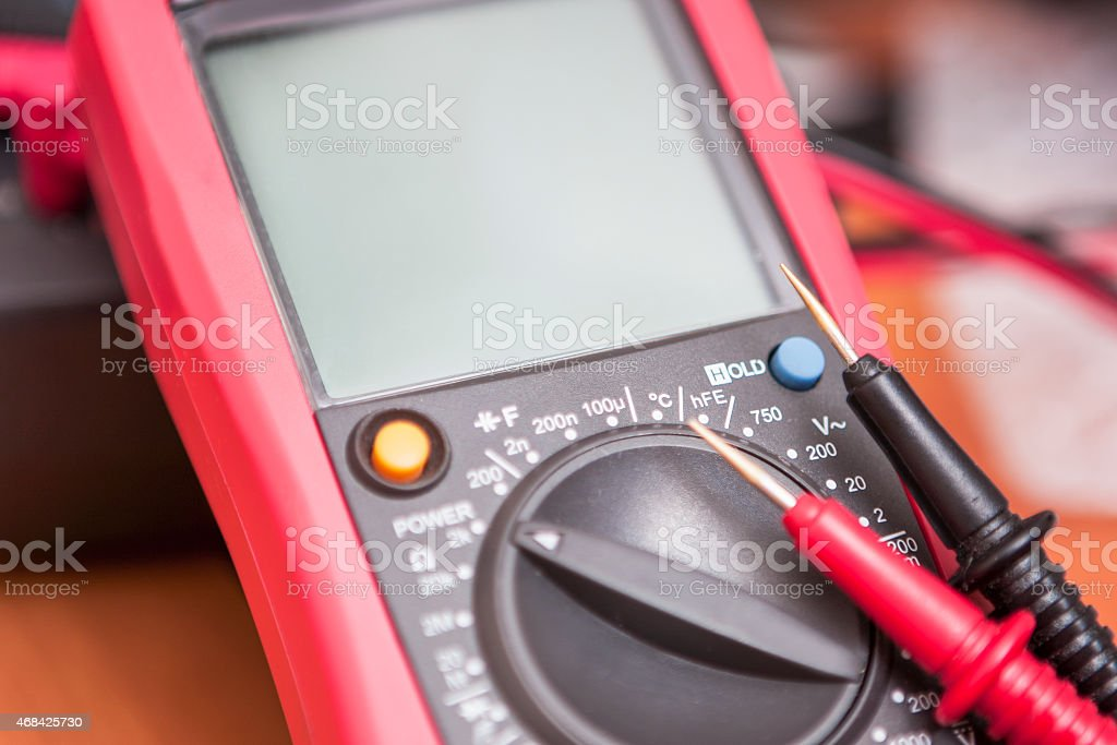 Closeup of Digital Multimeter Unit with Two Probes Connected stock photo
