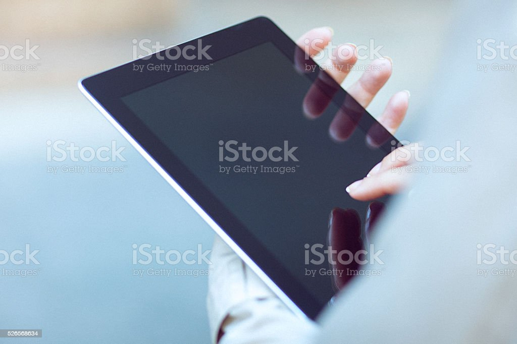 Close-up of digital tablet in a young businesswoman's hands stock photo