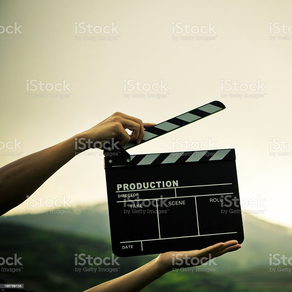 Close-up of director holding clapper board royalty-free stock photo