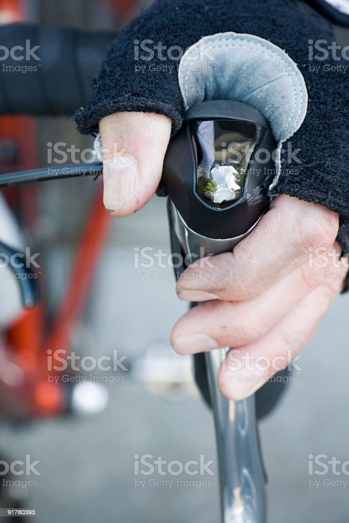 Close-up of Dirty Hand on Bicycle Brake royalty-free stock photo