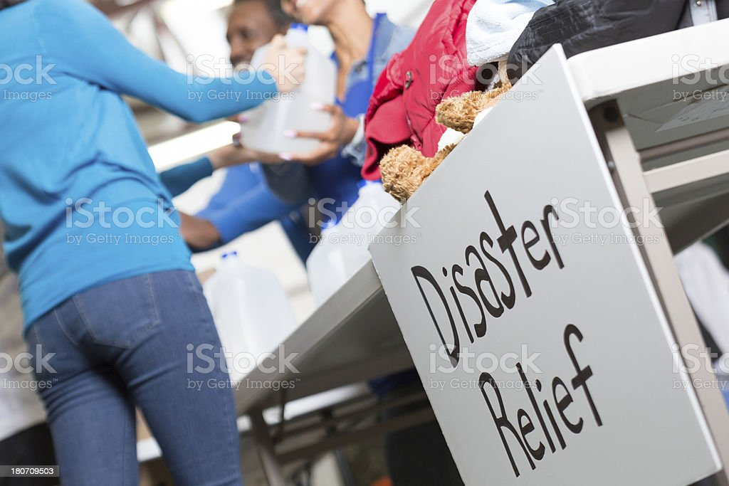 Closeup of Disaster Relief sign at center handing out water stock photo