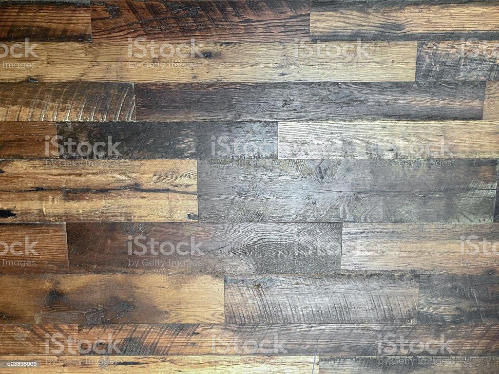 Closeup of distressed hardwood floor stock photo