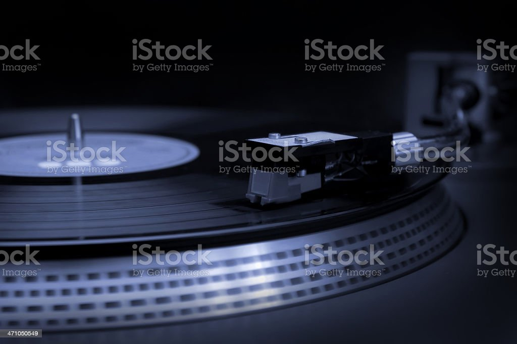 A close-up of DJ equipment and a record royalty-free stock photo