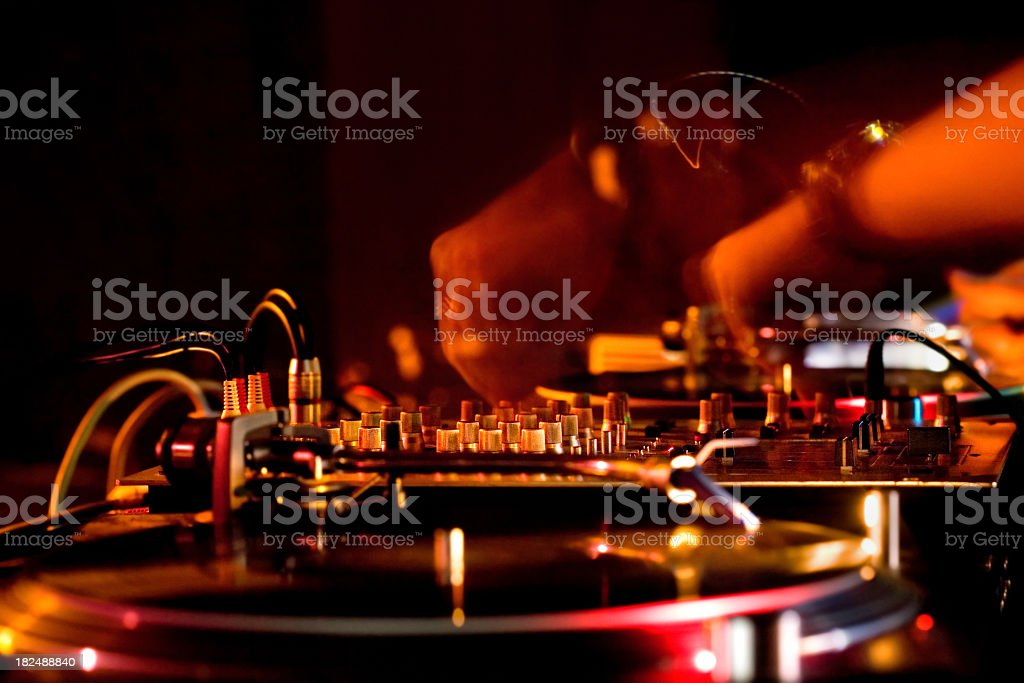 Close-up of DJ hands and sound equipment stock photo