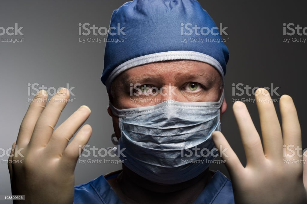Close-up of doctor preparing for surgery royalty-free stock photo
