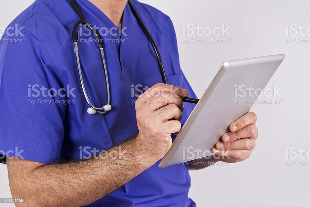 Close-up of Doctor using mobile tablet royalty-free stock photo