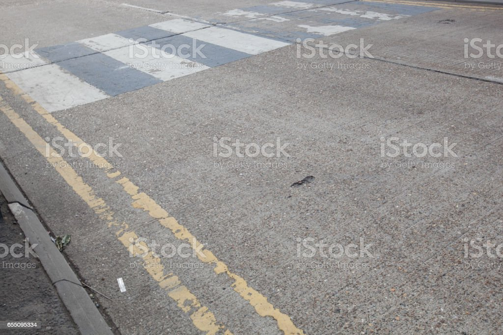 Close-Up of double yellow line on road and Zebra crossing stock photo